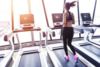 A woman exercising on a treadmill.