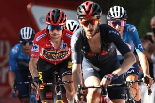 Overall leader Team Jumbos Slovenian rider Primoz Roglic 2L crosses the finish during the 7th stage of the 2021 La Vuelta cycling tour of Spain a 152 km race from Gandia to Balcon de Alicante in Tibi on August 20 2021 Photo by JOSE JORDAN AFP Photo by JOSE JORDANAFP via Getty Images