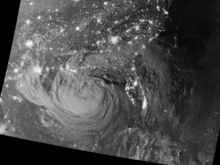 Tropical Storm Isaac photo from space at night.