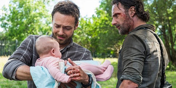 The Walking Dead Aaron holds baby Gracie with Rick Grimes AMC