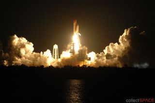 Night Lights: Shuttle Discovery Rockets Toward Space Station