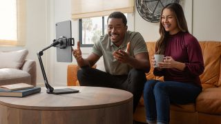 Best iPad stand: Two people using the Twelve South HoverBar Duo iPad stand to make a video call