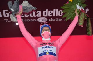 CAMIGLIATELLO SILANO ITALY OCTOBER 07 Podium Joao Almeida of Portugal and Team Deceuninck QuickStep Pink Leader Jersey Celebration Mask Covid safety measures Mascot Flowers during the 103rd Giro dItalia 2020 Stage 5 a 225km stage from Mileto to Camigliatello Silano 1275m girodiitalia Giro on October 07 2020 in Camigliatello Silano Italy Photo by Tim de WaeleGetty Images