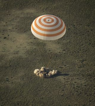 A Soyuz TMA-11M space capsule lands with Expedition 39 Commander Koichi Wakata of the Japan Aerospace Exploration Agency (JAXA), Soyuz Commander Mikhail Tyurin of Roscosmos, and Flight Engineer Rick Mastracchio of NASA near the town of Zhezkazgan, Kazakhs