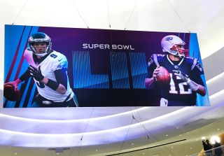 Super Bowl banner featuring Tom Brady and Nick Foles in the Mall. The two quarterbacks go head to head on Sunday in the big game. bold northeaglesfootballmallmall of americaminneapolisminnesotanew england patriotsnflnick folesphiladelphia eaglesquarterbac