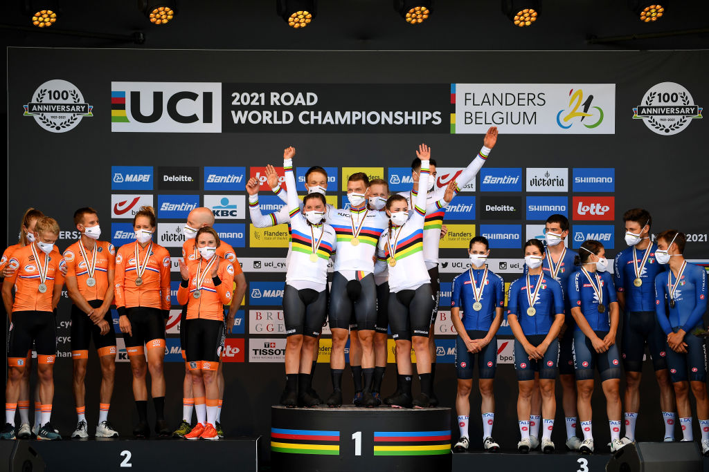 BRUGES BELGIUM SEPTEMBER 22 LR Silver medalists Koen Bouwman of Netherlands Riejanne Markus of Netherlands Bauke Mollema of Netherlands Ellen Van Dijk of Netherlands Jos Van Emden of Netherlands and Annemiek Van Vleuten of Netherlands gold medalists Tony Martin of Germany Mieke Kroger of Germany Lisa Brennauer of Germany Nikias Arndt of Germany Lisa Klein of Germany and Max Walscheid of Germany with world champion jerseys and bronze medalists Marta Cavalli of Italy Elena Cecchini of Italy Elisa Longo Borghini of Italy Edoardo Affini of Italy Filippo Ganna of Italy and Matteo Sobrero of Italy celebrate on the podium during the medal ceremony after the 94th UCI Road World Championships 2021 Team Time Trial Mixed Relay a 445km race from KnokkeHeist to Bruges the day cyclist Tony Martin of Germany withdraws from professional cycling flanders2021 TT on September 22 2021 in Bruges Belgium Photo by Tim de WaeleGetty Images
