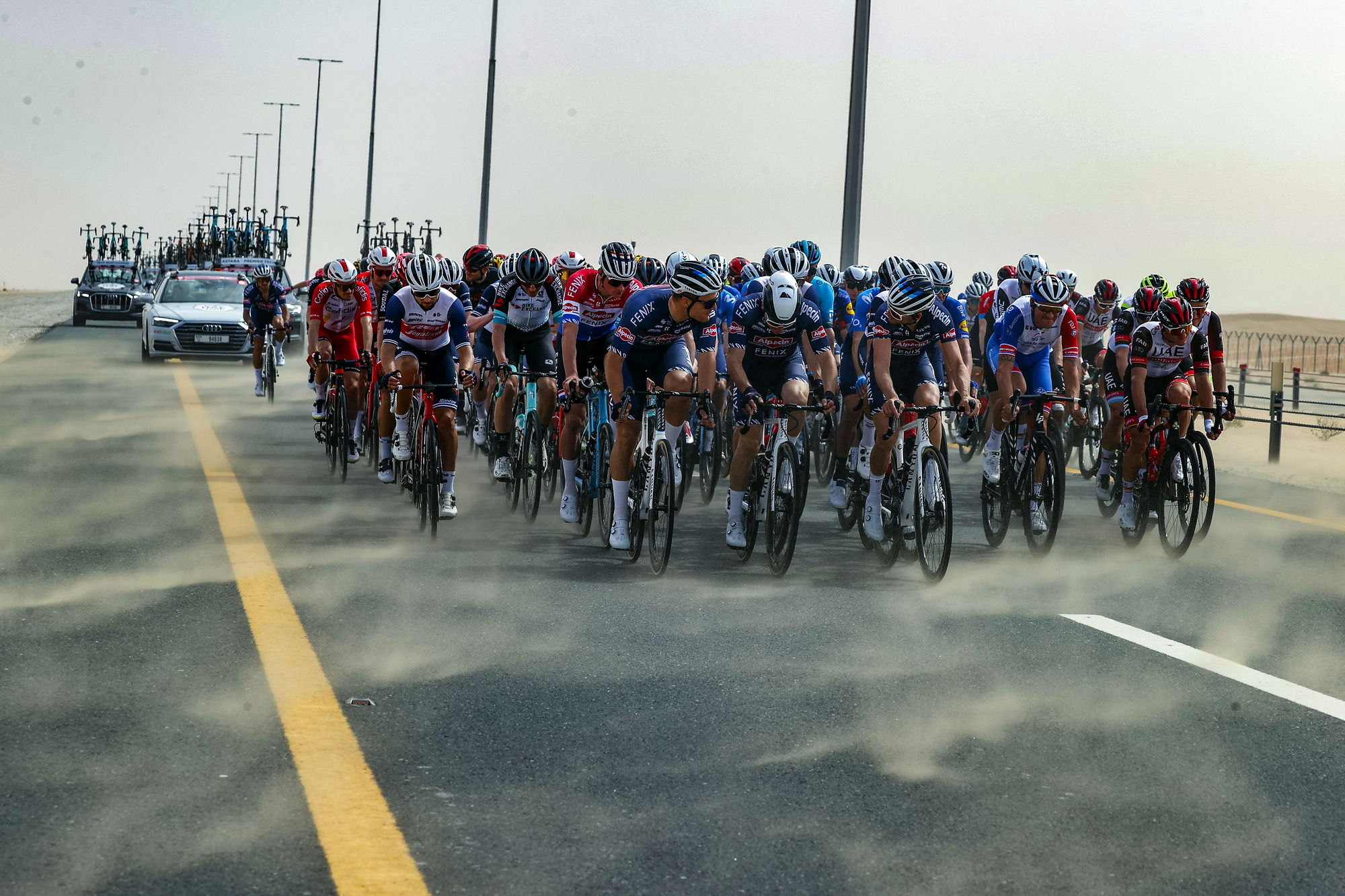 The desert winds at the UAE Tour blew sand across the road