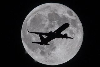 Plane Crossing the Moon by Raul Roa