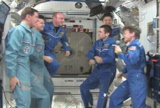 New Crew Takes Charge of Space Station