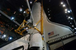 NASA's space shuttle is positioned to attach the fuel tank and boosters for its final mission.