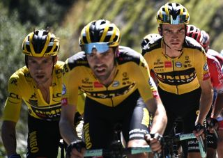 Team Jumbo rider Slovenias Primoz Roglic l wearing the overall leaders yellow jersey climb flanked by his teammate Team Jumbo rider US Sepp Kuss R during the fourth stage of the 72nd edition of the Criterium du Dauphine cycling race 153 km between Ugine and Megeve on August 15 2020 Photo by AnneChristine POUJOULAT AFP Photo by ANNECHRISTINE POUJOULATAFP via Getty Images