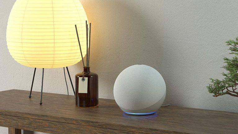 best smart speaker: Amazon Echo on surface beside lamp and diffuser