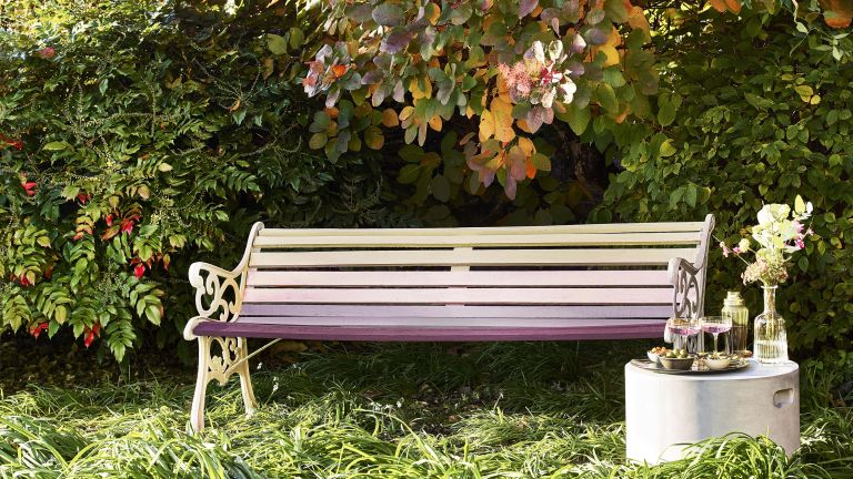 painting garden furniture: garden bench painted in a number of colourful exterior paints