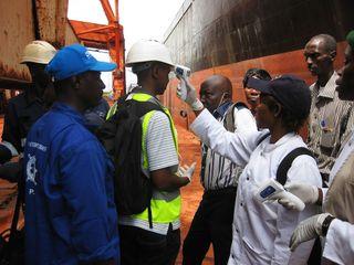 Ebola temperature check in Guinea