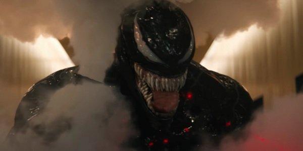 Venom gleefully grabs a smoke grenade in the lobby