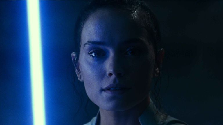 "Best Star Wars movies: ""Star Wars: The Rise of Skywalker"" still image of Rey, blue background"