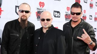 Donegan, right, with bandmates Mike Wengren and David Draiman
