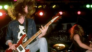 American songwriter and former bass player member with Metallica, Cliff Burton (1962-1986), and American songwriter, guitarist, lead vocalist and founding member of Metallica James Hetfield perform at the Royal Oak Music Theatre in Royal Oak, MI on February 1, 1985.