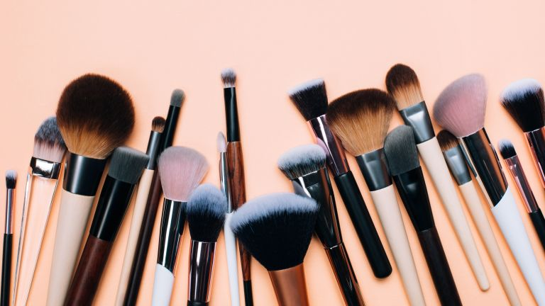 flatlay of selection of make-up brushes