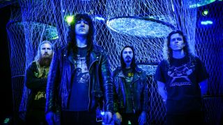 Metal band Vektor standing in a line in blue light