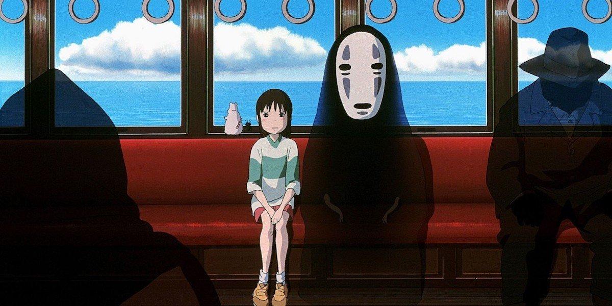 Chihiro on a train on Spirited Away.