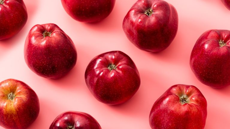 red apples on a pink background