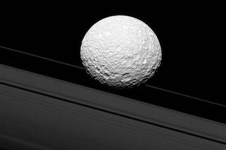 Saturn's rings and moon Mimas
