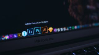 Adobe Creative Cloud discount - MacBook taskbar with Adobe CC product icons shown