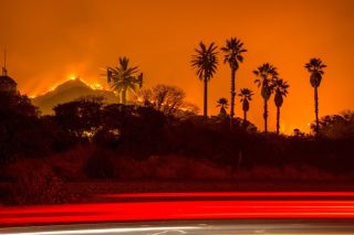 The Thomas Fire burns along a hillside near Santa Paula, California, on Dec. 5, 2017.