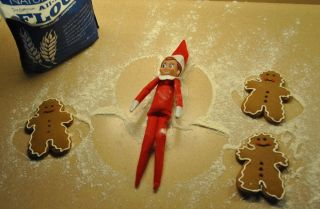 an elf on the shelf making a sugar angel