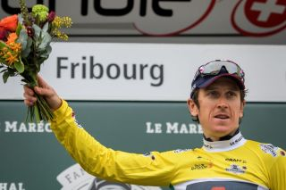 Britains Geraint Thomas celebrates with his yellow jersey of overall leader during the podium ceremony of the final stage 161 km race against the clock Fribourg to Fribourg during the Tour de Romandie UCI World Tour 2021 cycling race on May 2 2021 in Fribourg Photo by Fabrice COFFRINI AFP Photo by FABRICE COFFRINIAFP via Getty Images