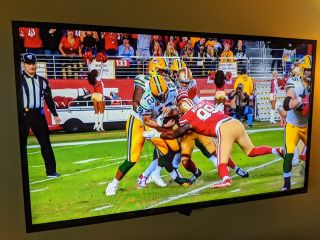 NFL Packers and 49ers Aaron Rodgers sack on TV