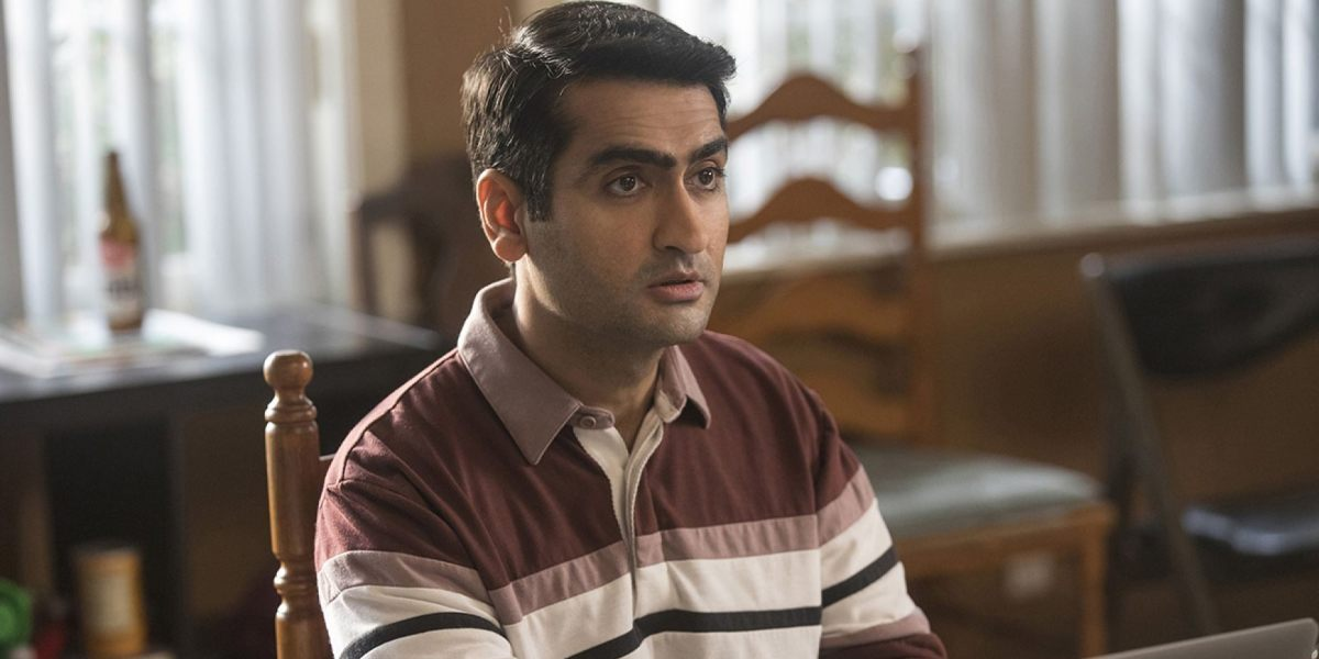 Dinesh (Kumail Nanjiani) sits in a wooden chair in a scene from 'Silicon Valley'