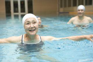 A few older women doing water aerobics.