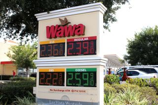 Gasoline prices displayed at a Wawa store in Orlando, Florida.
