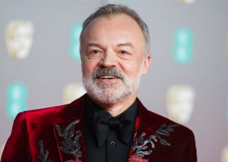 Graham Norton hosts 'Queen Of The Universe' for a global audience.