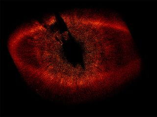 This Hubble Space Telescope image shows a protoplanetary disk of dust around the nearby star Fomalhaut (HD 216956).