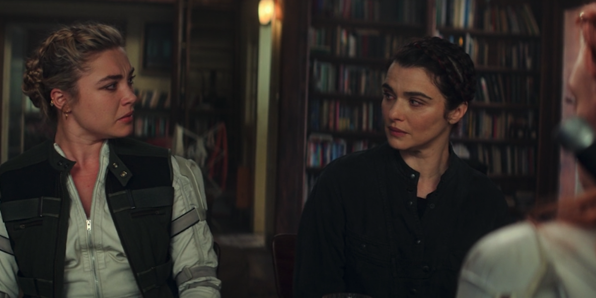 Florence Pugh with Rachel Weisz during family table scene in Black Widow