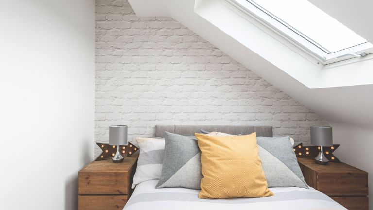 bedroom in loft conversion with white scheme photographs by fraser marr