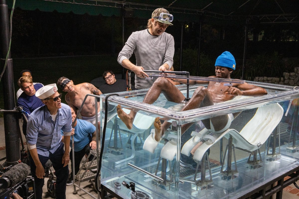 Eric Manaka prepares for a water stunt as Johnny Knoxville and team watch in Jackass Forever.