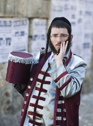 An Orthodox Jewish man wearing peyos.