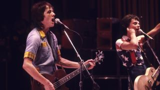 Ian Mitchell and Stuart Wood of the Bay City Rollers performing on stage
