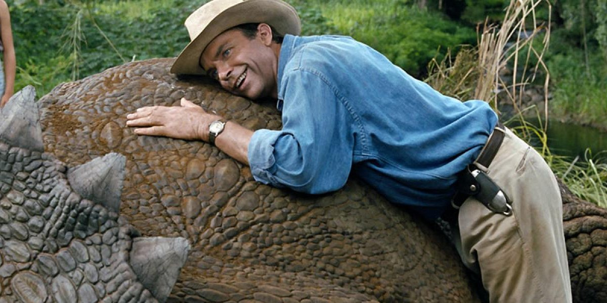 Alan Grant lies on a triceratops in Jurassic Park