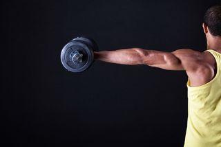 A man lifts weights