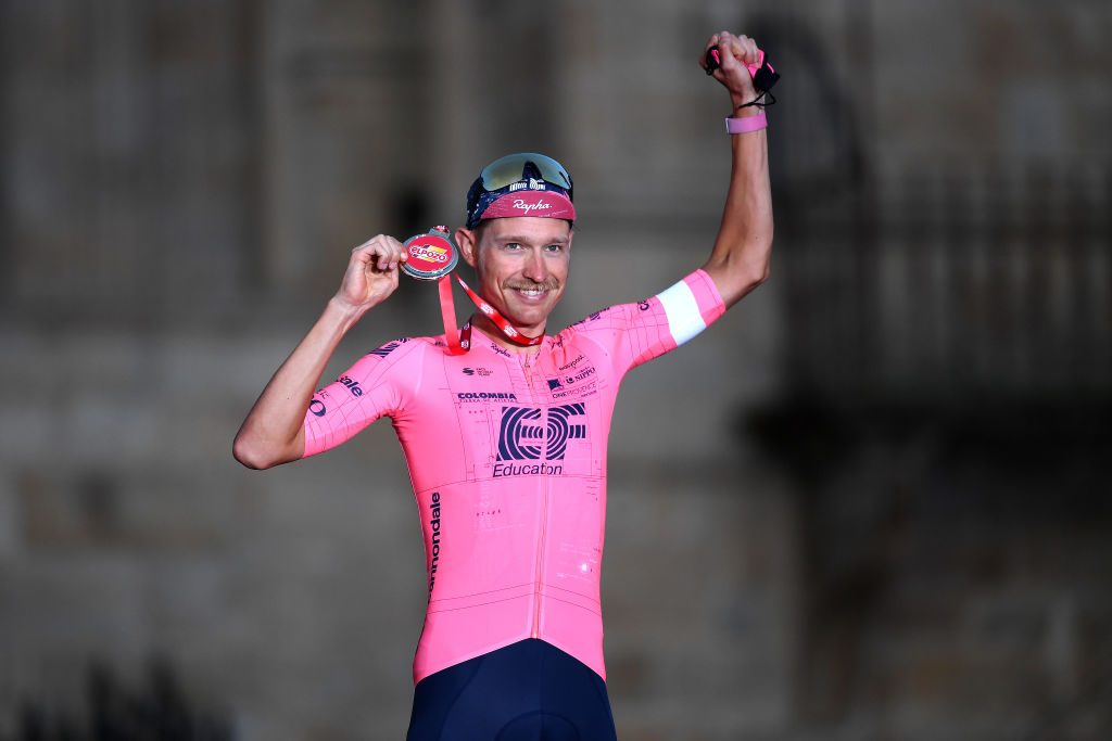 SANTIAGO DE COMPOSTELA SPAIN SEPTEMBER 05 Magnus Cort Nielsen of Denmark and Team EF Education Nippo celebrates winning the most combative trophy on the podium ceremony after the 76th Tour of Spain 2021 Stage 21 a 338 km Individual Time Trial stage from Padrn to Santiago de Compostela lavuelta LaVuelta21 ITT on September 05 2021 in Santiago de Compostela Spain Photo by Tim de WaeleGetty Images