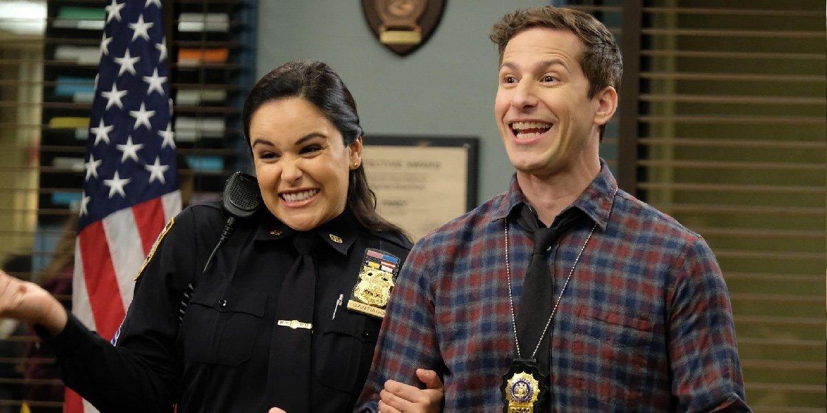 Melissa Fumero as Amy Santiago and Andy Samberg as Jake Peralta in Brooklyn Nine-Nine.