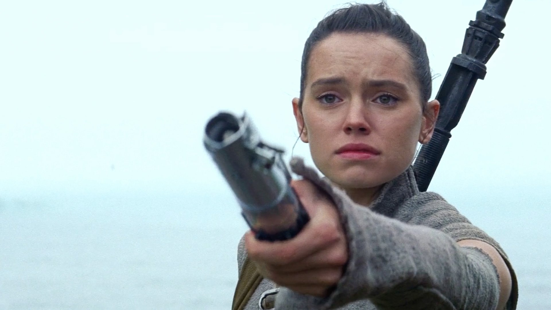 Rey holds out lightsaber Star Wars The Force Awakens Lucasfilm