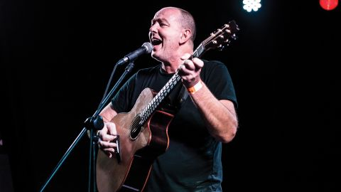A photograph of Francis Dunnery on stage