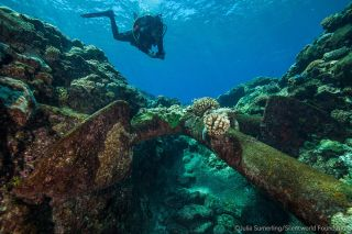 James Hunter, an archaeologist with the Australian National Maritime Museum, records an anchor from one of the wrecks at Kenn Reefs with a photogrammetry camera.