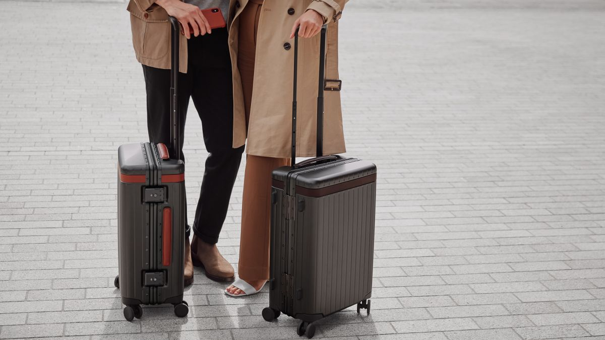 This aluminium and Italian leather carry-on suitcase is both stylish AND practical